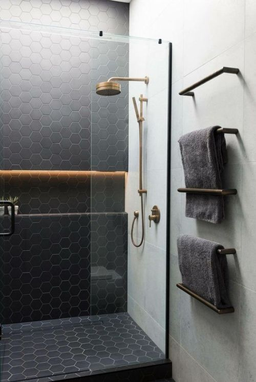 Matte Black Hex Tiles Accented With Neutral Grout And Paired With Large Scale Neutral Tiles