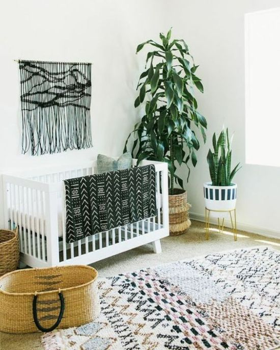 Monochromatic Boho Nursery With A Black Macrame Hanging