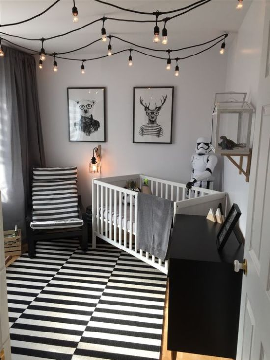 Monochromatic Nursery With A Striped Rug And Chair