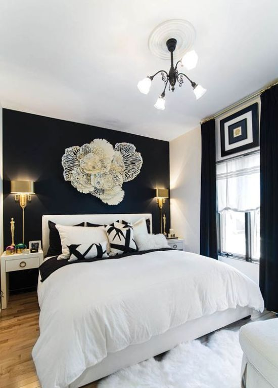Refined Black And White Bedroom With A Statement Wall