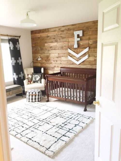 Rustic Nursery With A Printed Rug A Stained Crib A Reclaimed Wall And Some Touches Of Prints