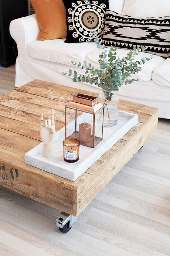 Rustic Wooden Coffee Table With A Marble Tray And A Copper Lantern