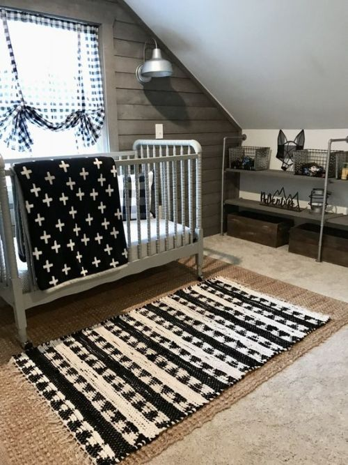Small Attic Nursery With A Jute Rug A Printed One A Grey Vintage Crib Prints And A Reclaimed Wooden Wall