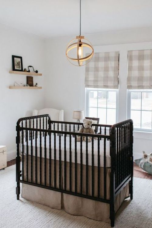 Small Yet Cozy Nursery With Plaid Roman Shades A Vintage Black Crib A Sphere Pendant Lamp And Floating Shelves