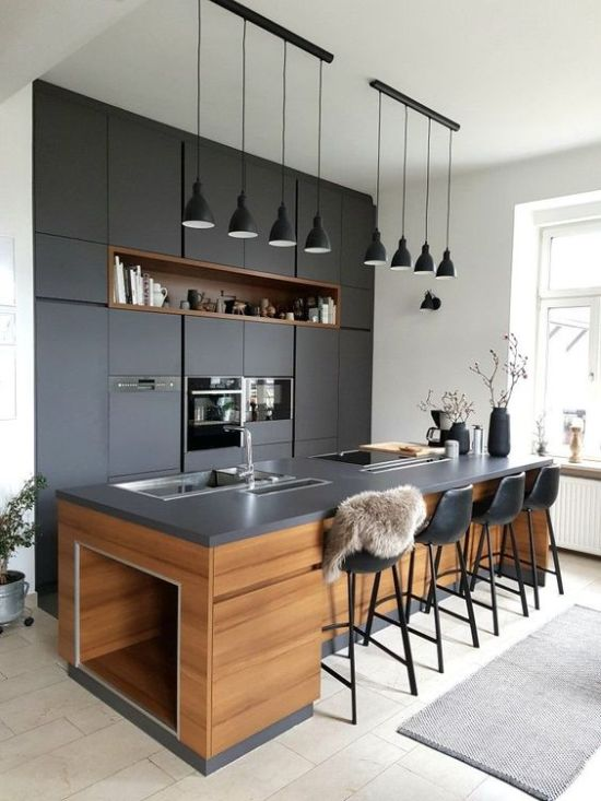 Super Chic Dark Kitchen With Matching Blakc Pendant Lamps Hanging In A Row Is A Cool And Bold Idea