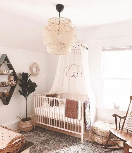 Warm-Colored Boho Nursery With A Boho Rug