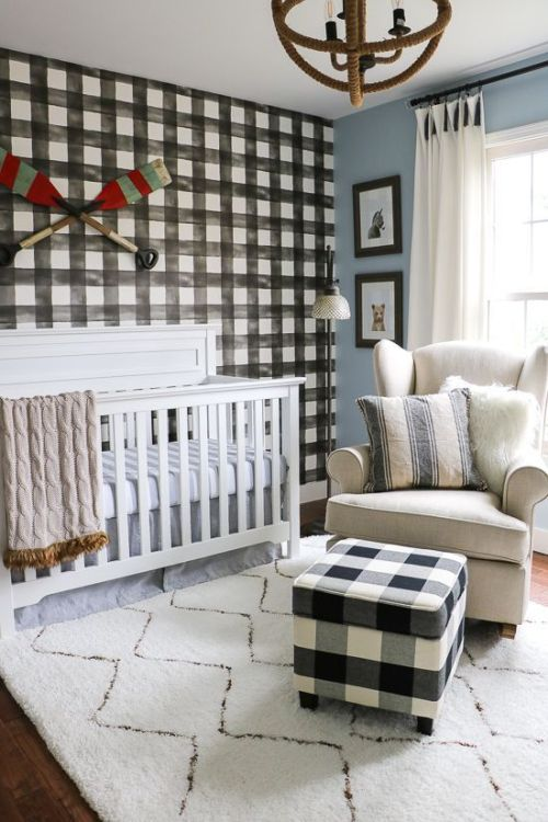 Welcoming Farmhouse Nursery With A Plaid Statement Wall And A Matching Ottoman Neutral Furniture And A Unique Sphere Chandelier