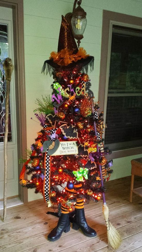 Halloween Tree Decoration Ideas With A Broom With Lights Ornaments And Hats And Letters For Fun