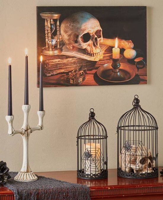A Bone Candelabra With Tall Black Candles For A Timeless Halloween Decoration