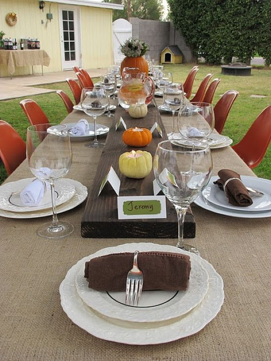 A Bright Tablescape With A Wooden Table Runner Pumpkin Candleholders A Pumpkin Vase With Blooms