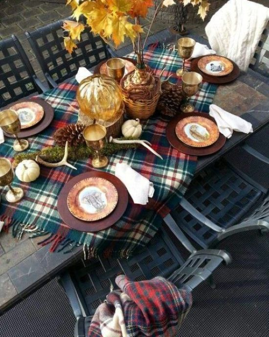 A Bright Thanksgiving Table With Antlers Pumpkins Pinecones A Plaid Tablecloth And A Fall Leaf Arrangement