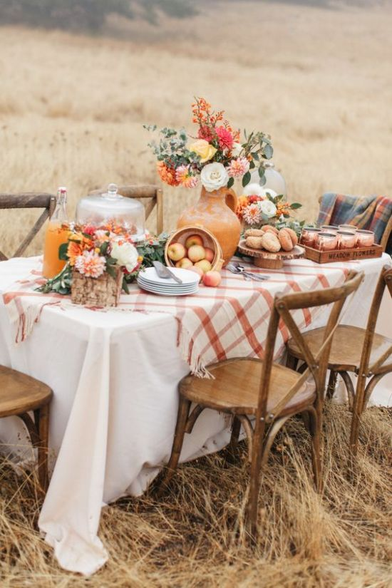 A Chic And Bright Thanksgiving Table With Bright Florals White Pumpkins In Cloches And A Plaid Tablecloth