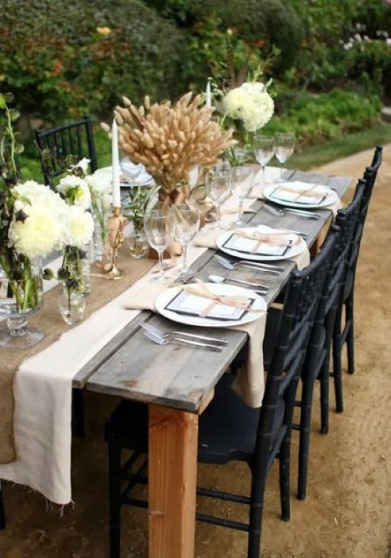A Cozy And Neutral Thanksgiving With A Burlap Runner A Wheat Centerpiece Neutral Blooms And Candles In Gold Candleholders