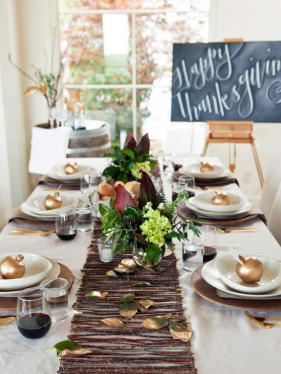 A Modern Fall Or Thanksgiving Tablescape With A Stick And Foliage Table Runner Brown Chargers Gilded Apples And Dark Floral Centerpieces
