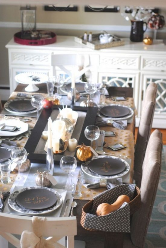 A Modern Thanksgiving Table Setting Done In Greys Metallic And Black Pillar Candles And Gourds In A Basket