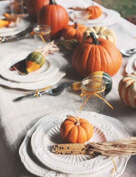 A Natural Tablescape With Pumpkins Corn Cobs Husks Candles And Some Elegant Vintage Plates