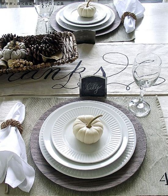 A Neutral Thanksgiving Tablescape With A Neutral Table Runner Placemats A Basket With Pinecones And Berries Chalkboard Tags