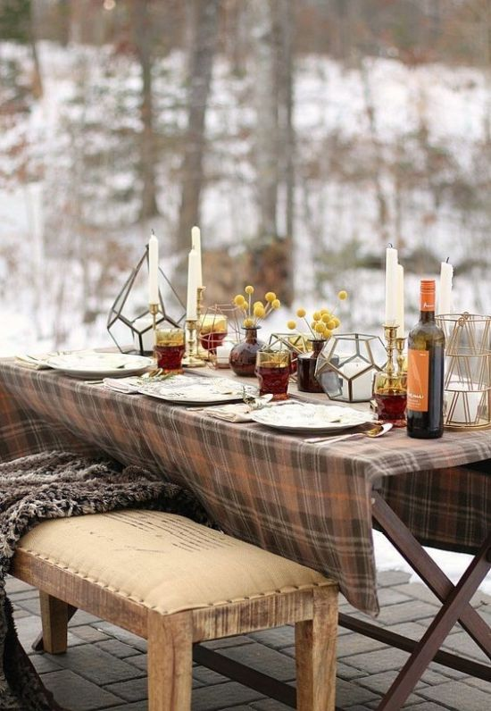 A Simple And Cozy Thanksgiving Tablescape With Candles Billy Balls In Apothecary Jars Lanterns And A Plaid Tablecloth