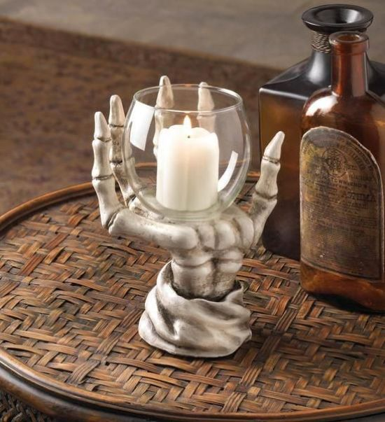 A Skeleton Hand Holding A Glass With A Candle For A Creative And Bold Idea For Halloween