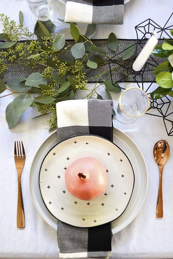 A Stylish Monochromatic Thanksgiving Table With A Printed Runner Greenery White Candles Printed Napkins And Plates And Gold Touches