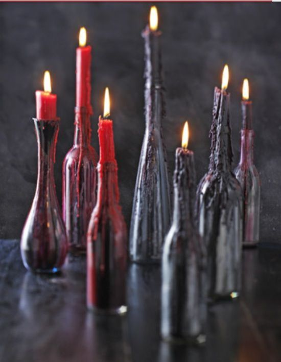 Black Bottles With Red And Deep Purple Wax From Candles
