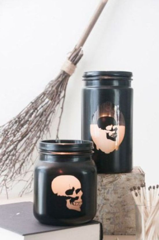 Jars Painted Black With Skull Stencils On Them For A Nice Halloween-Like Idea And A Modern Party