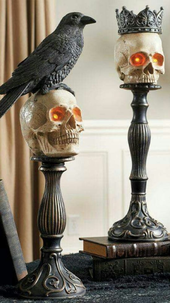 Refined Metal Candleholders Used As Holders For Skulls And Other Types Of Decor