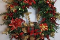 A Beautiful Christmas Wreath Of Evergreens With Poinsettia Gift Boxes And Ribbon Bows Plus Ornaments