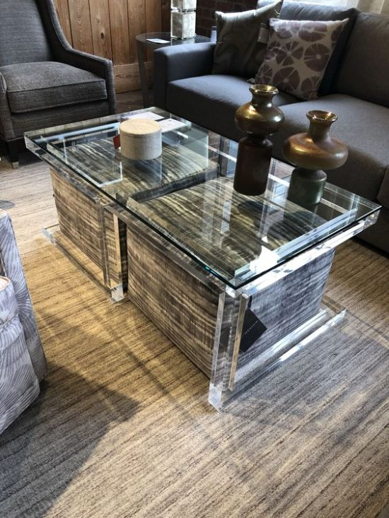 A Clear Glass Coffee Table With Large Upholstered Ottomans With Storage Space Inside