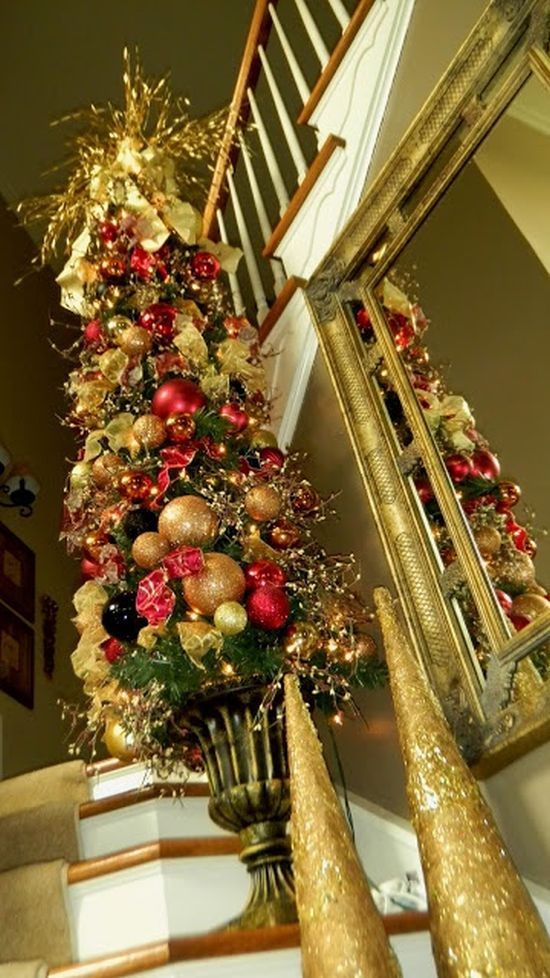 A Red And Gold Christmas Mini Tree Composed Of Ornaments And Bows