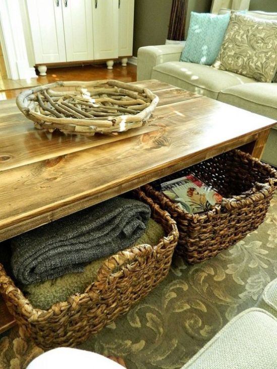 A Wooden Coffee Table With A Niche Inside And Basket Drawers