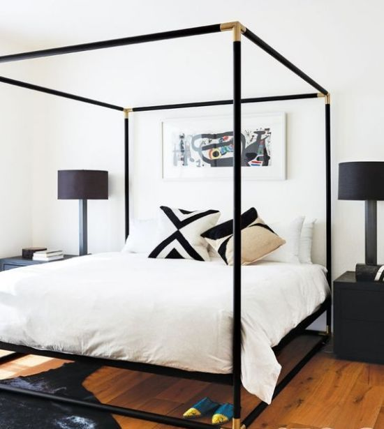 Black Canopy Bed With Gilded Corners