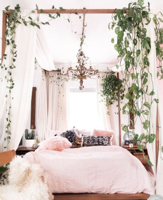 Canopy Bed With Fresh Greenery