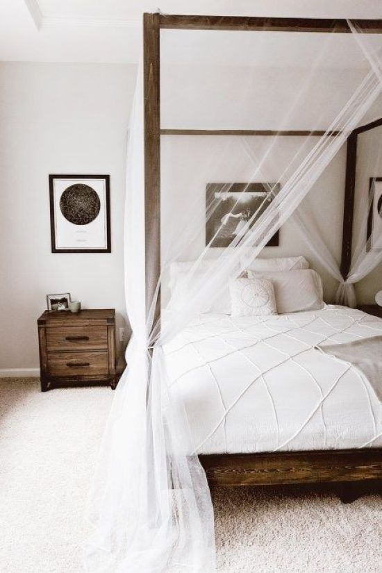 Canopy Bed With Sheer And Airy White Curtains