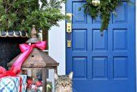 Christmas Front Door Decoration Ideas With A Large Lantern Filled With Colorful Ornaments