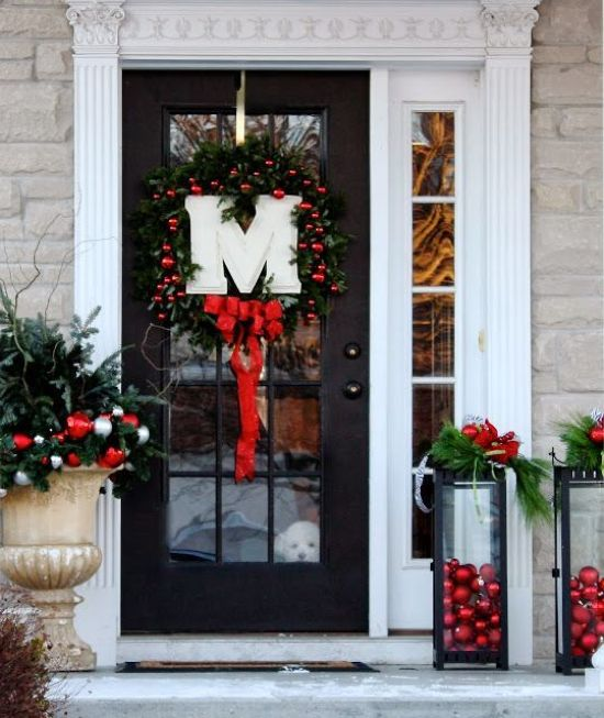 Christmas Front Door Decoration Ideas With A Monogram And Candles With Red Ornaments Inside