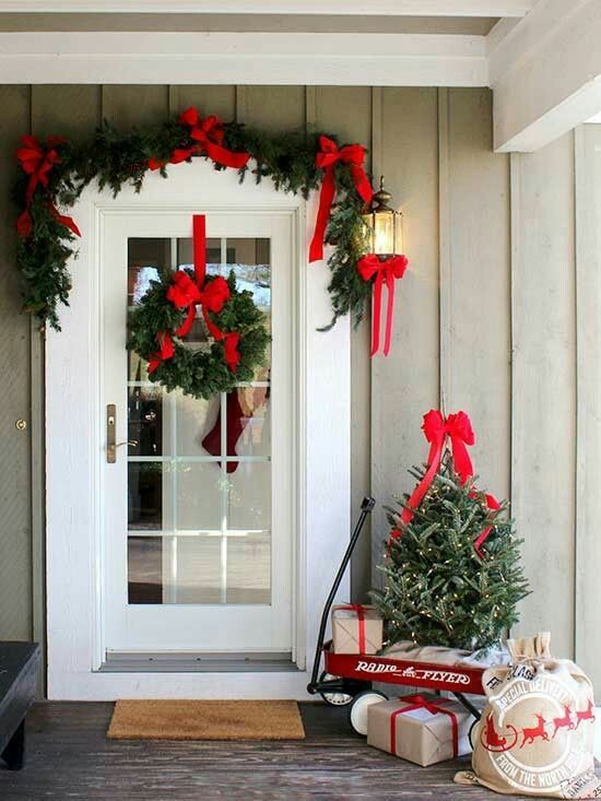 Christmas Front Door Decoration Ideas With An Evergreen Garland With Red Bows