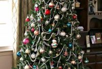 Christmas Tree With Colorful Vintage Ornaments And Beaded Garlands Plus Lights For A Chic And Bold Look