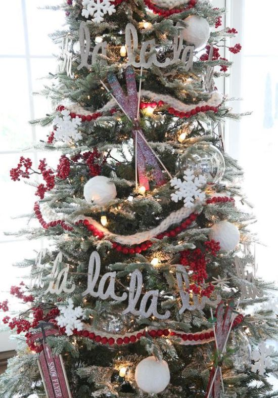 Flocked Christmas Tree With Lights Cranberry Garlands Letters Skis And Sleighs