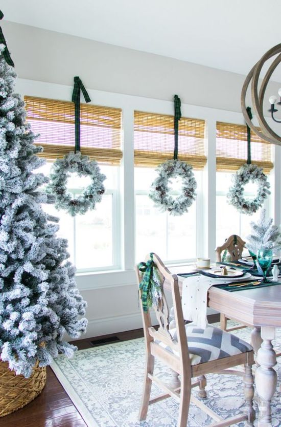 Neutral Winter Home Decor Ideas With A Flocked Christmas Tree In A Basket