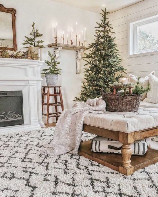Neutral Winter Home Decor Ideas With Mini Christmas Tree In Buckets And A Christmas Tree With Lights