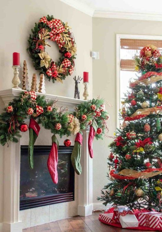 Red And Gold And Green Christmas Decor With Stockings Plus A Wreath And A Tree With Ribbons And Ornaments