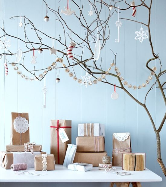 Scandinavian Christmas Decorating Ideas With A Garland Plus Gift Boxes Wrapped In Kraft Paper