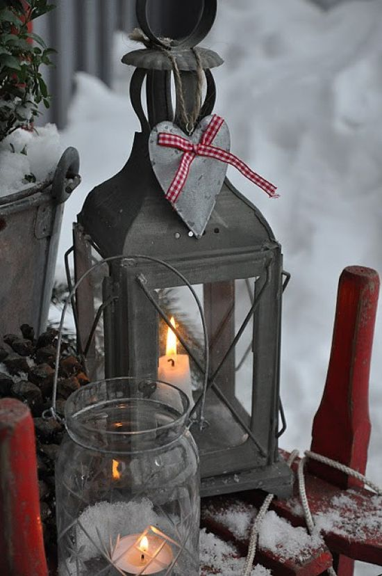Scandinavian Christmas Decorating Ideas With A Metal Candle Lantern With A Fabric Heart