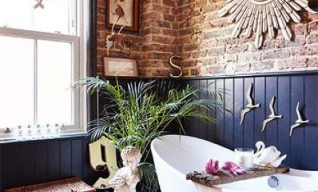 Bathroom With Red Brick And Navy Paneling Walls