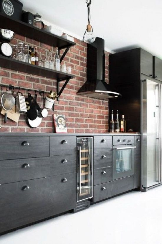 Black Kitchen With A Red Brick Backsplash