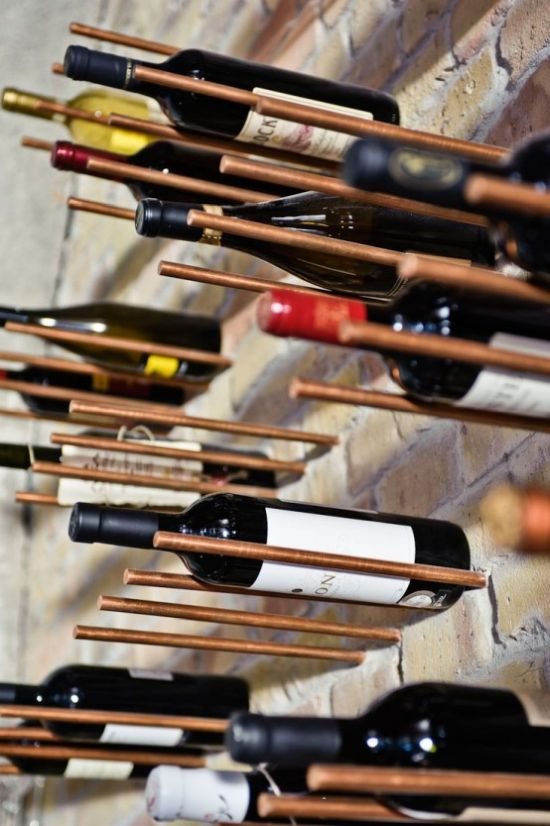 Brick Wall With Copper Metal Wine Storage Dowels