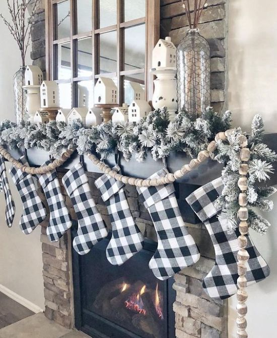 Christmas Mantel Decor With Buffalo Check Stockings Plus Flocked Evergreens And Wooden Bead Garlands