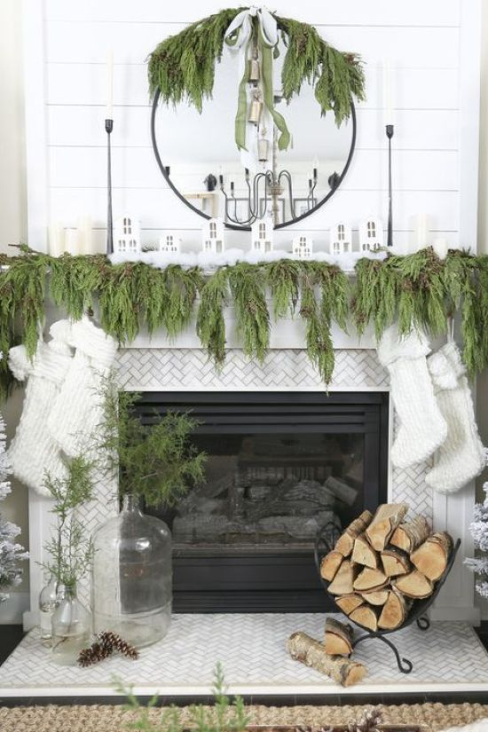 Christmas Mantel Decor With Garland And Mirror Plus White Stockings