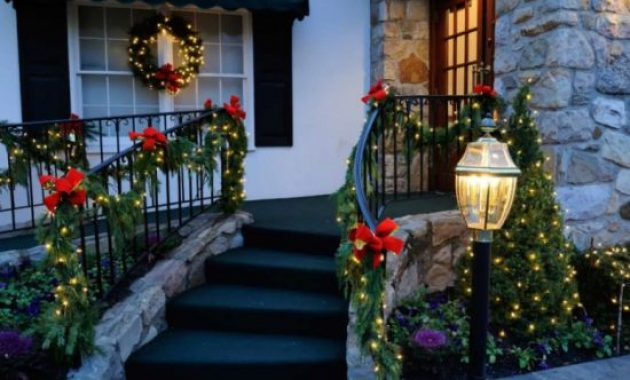 Christmas Porch Decor With Outdoor Railings Interwoven With Lights